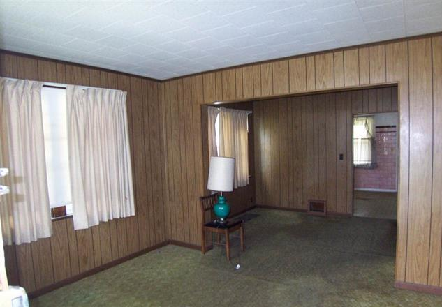Covering wood paneling and uncovering wood floors real How to cover old wood paneling